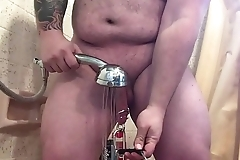 Pierced Johnson Penis stretched with 10L bucket of water