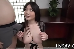 Horny young oriental groans while bring pleasured with dildo
